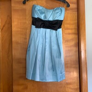 Flowy and strapless light blue and black bow